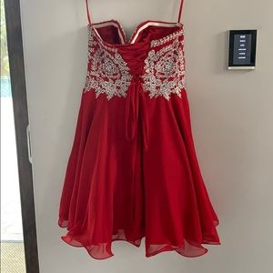 Beautiful red and silver sequined cocktail dress.